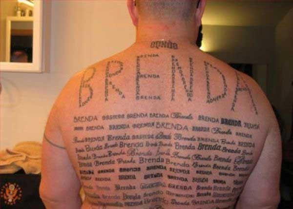 brenda tattooed on mans back in hundreds of different ways and fonts