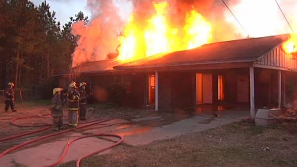 House on fire after setting snake on fire