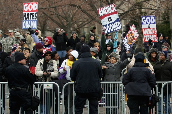 Westboro Baptist Church picket signs crowd held back by polic