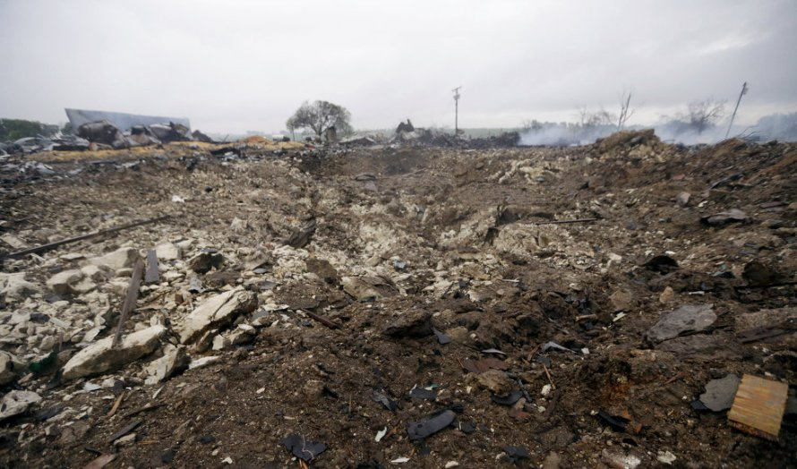 A blast crater sits in the remains of a fertilizer plant destroyed by an explosion in West, Texas, Thursday, April 18, 2013. (AP Photo/LM Otero) Source