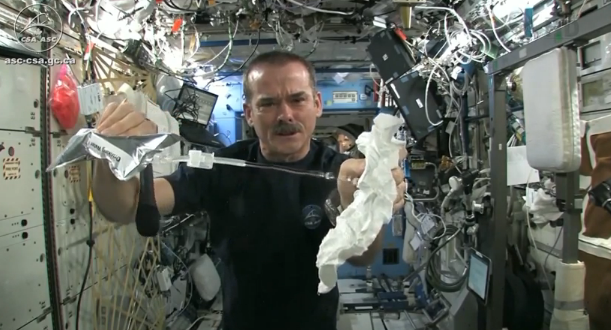 Wringing a washcloth out in space zero gravity