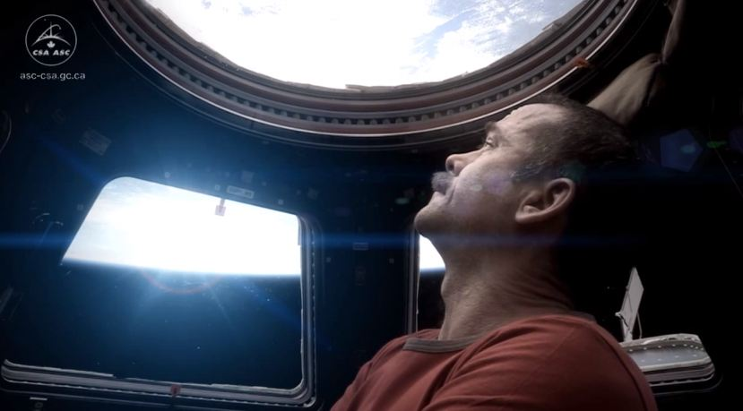 Chris Hadfield ISS singing Space Oddity looking out window