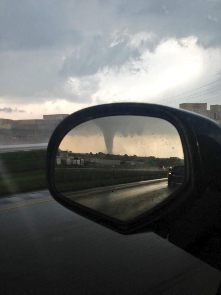 I'll bet this guy was glad to see the Moore tornado in his rear-view mirror rather than out his front windshield.
