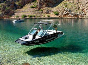 optical illusion boat floating above water