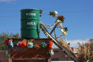 Water (agua) don't need no stinking passport. Protesting the diversion of water to those who profit.
