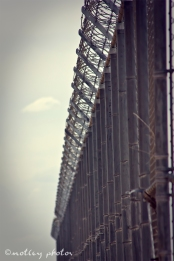 Fence line around the Santa Fe Old Main prison.