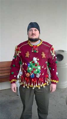 Ugly Christmas sweater with dangling ornaments.