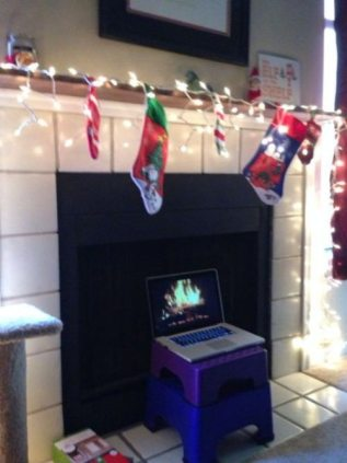 Laptop used for a fireplace roaring fire.