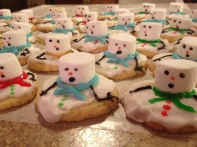 Melting snowman shaped cookies.
