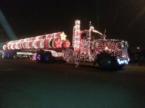 Semi-truck covered with Christmas lights.