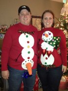 Ugly Christmas sweaters. Anatomically correct snowmen/snow-woman.