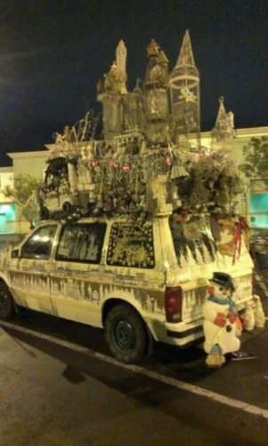 A very large - and indescribable - Christmas decorated van.