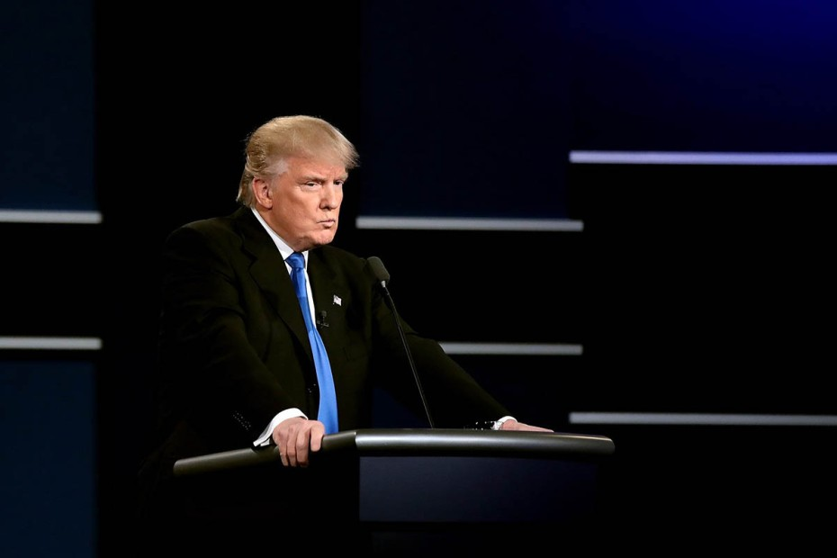 HEMPSTEAD, NY - SEPTEMBER 26:  Republican presidential nominee Donald Trump looks on during the Presidential Debate at Hofstra University on September 26, 2016 in Hempstead, New York.  The first of four debates for the 2016 Election, three Presidential and one Vice Presidential, is moderated by NBC's Lester Holt.  (Photo by Drew Angerer/Getty Images)